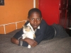 Robert Nyambane with his pet cat.  SCANN children are permitted to have pets as a way for them to learn responsibility.
