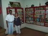 Shamsher poses with Joanna Boynton (one of SCANN's valued sponsors) in the SCANN library